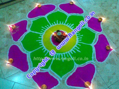 green yellow flower rangoli
