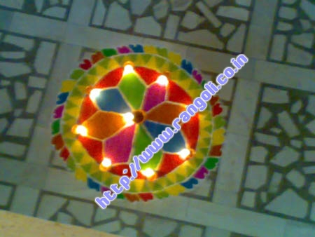 flower rangoli with border diya